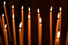 A lot of Church candles on black background Stock Photography