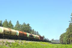 A lot of cisterns freight train on the run in summer, transportation of combustible lubricants. A lot of cisterns freight train on the run in summe stock images