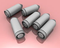 A lot of clean new glossy bullets / 3d image. 3d picture with 6 bullets on red background Stock Photography