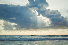A lot of cloud over long tail boat on the andaman sea Stock Photo