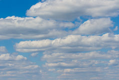 A lot of clouds. Blue sky and a lot of white clouds Royalty Free Stock Image