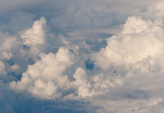 A lot of clouds. Blue sky and a lot of white clouds. View from aircraft window Royalty Free Stock Image