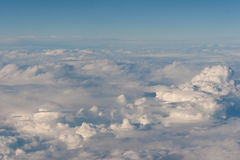 A lot of clouds. Blue sky and a lot of white clouds. View from aircraft window Royalty Free Stock Images