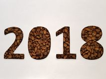 Number 2018 with roasted coffee beans and white background, design for new year celebration. Lot of coffee beans toasted, ingredient for drinks with caffeine stock photos