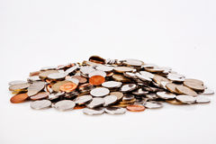 Lot of coins different tipes on white background Stock Photo