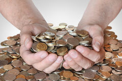 A lot of coins in the hands of men Royalty Free Stock Photo