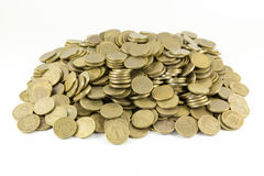 A lot of coins on a white background Stock Photos