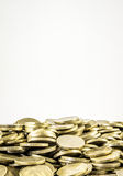 A lot of coins on a white background Royalty Free Stock Image