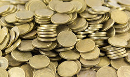 A lot of coins on a white background Royalty Free Stock Photo