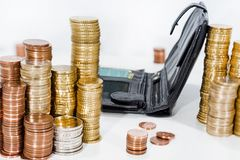 A lot of coins on white table with black purse. Stock Image