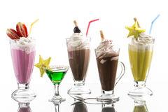 Lot of cold frappes with absinth cocktail on the bright backgrou Stock Image