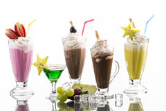 Lot of cold frappes with absinth cocktail on the bright backgrou Royalty Free Stock Photos