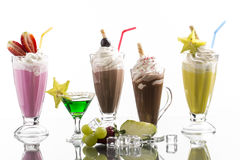 Lot of cold frappes with absinth cocktail on the bright backgrou Stock Images