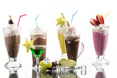 Lot of cold frappes with absinth cocktail on the bright backgrou Stock Photos