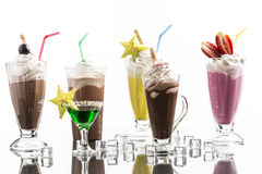 Lot of cold frappes with absinth cocktail on the bright backgrou Royalty Free Stock Photography