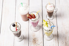 Lot of cold frappes on the wooden background Royalty Free Stock Images