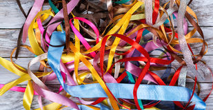 A lot of color ribbons on wooden background. Top view. Stock Photography