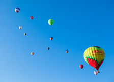 A lot of colored balloons in blue sky Stock Image