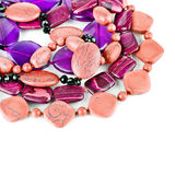 Lot of colored beads from different minerals. Stone background