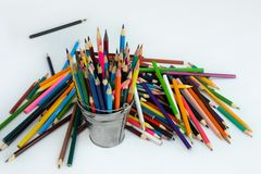 A lot of colored children`s pencils for drawing in a tin bucket stock photography