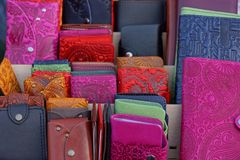 Colored leather purses in the display case Stock Photos