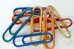 Paperclip. Lot of colored metal paperclips Royalty Free Stock Photos