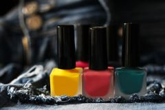 A lot of colored nail Polish and the jeans Stock Images