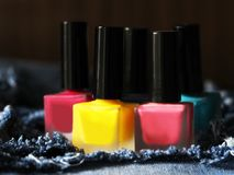 A lot of colored nail Polish and the jeans Royalty Free Stock Photo