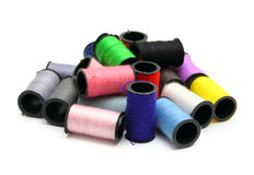 Lot of colored thread spools Stock Photos