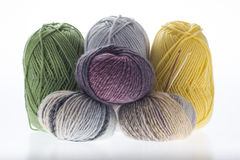 Lot of colored yarns on bright background Royalty Free Stock Photo