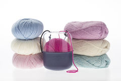 Lot of colored yarns on bright background Royalty Free Stock Photography