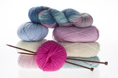 Lot of colored yarns on bright background Stock Photos