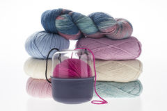 Lot of colored yarns on bright background Stock Image