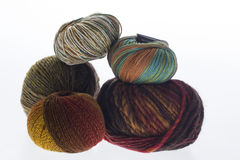 Lot of colored yarns on bright background Royalty Free Stock Image