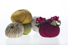 Lot of colored yarns on bright background Stock Photography