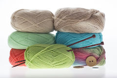 Lot of colored yarns on bright background Stock Photo