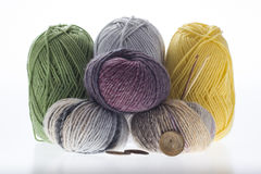 Lot of colored yarns on bright background Stock Images