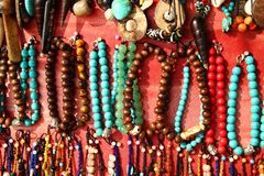 A lot of colorful bracelets and beads. royalty free stock photo