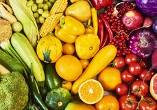 Colorful fruits and vegetables background. Rainbow collection royalty free stock images