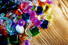 Lot of colorful glass beads and bright colors on wood Royalty Free Stock Photo