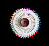 Lot of colorful pins on a black background Stock Photography