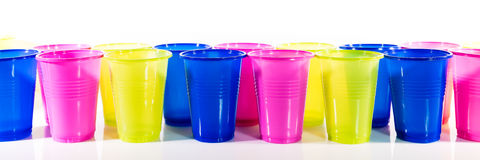 Lot of colorful plastic mugs Royalty Free Stock Photo