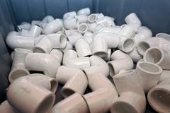 Fittings for plastic pipes. A lot of combined fittings for plastic pipes stock image