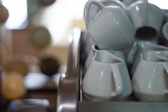 A lot of creamers on coffee machine in cafe. Blurred background, soft focus. Ho-re-ca sphere royalty free stock photos
