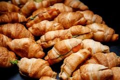 A lot of croissants on event catering. A lot of croissants with vegetables on event catering royalty free stock image