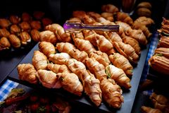 A lot of croissants on event catering. A lot of croissants with vegetables on event catering royalty free stock photo