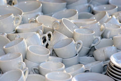 A lot of cups. Many tea cups in the city markt Stock Photo