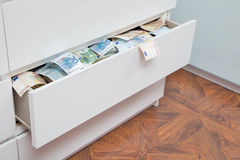 A lot of currency in the drawer Stock Photo