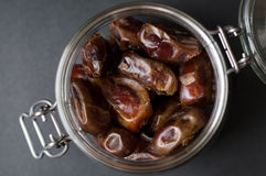 A lot of dates in a glass jar Stock Images