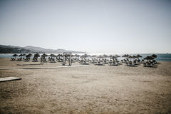 Lot of deck chairs in the beach with nobody. Beach with a lot of deck chairs close to the sea shore Stock Photography